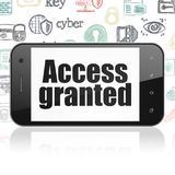 Privacy concept: Smartphone with Access Granted on display. Privacy concept: Smartphone with  black text Access Granted on display,  Hand Drawn Security Icons Royalty Free Stock Photos