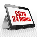 Privacy concept: Tablet Computer with CCTV 24 hours on display. Privacy concept: Tablet Computer with red text CCTV 24 hours on display, 3D rendering Stock Photo