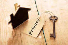 Privacy concept - vintage key with tag with inscription Stock Photos