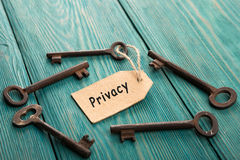 Privacy concept - vintage key with tag with inscription Royalty Free Stock Image