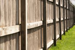 Privacy Fence. Six foot tall wooden privacy fence, common in suburbs Royalty Free Stock Photo