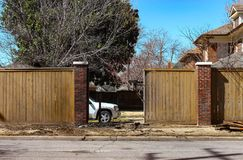 Privacy fence repair - Truck parked inside yard where a wreck has occured and fence is being rebuilt.jpg. Privacy fence repair - With Truck parked inside yard Stock Photo