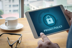 PRIVACY POLICY   Private Security Protection). Computing Computer  Laptop with screen on table Silhouette and filter sun Royalty Free Stock Photo