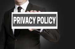 Privacy Policy sign is held by businessman Royalty Free Stock Photography