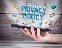 Privacy policy. Tablet computer in the hand. Old wooden background Royalty Free Stock Photos