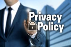 Privacy Policy touchscreen is operated by businessman Stock Photo