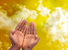 PRIVACY SPIRITUAL. Male hands in spiritual intimacy in a yellow sky panorama with rays to wilt answer prayers Royalty Free Stock Photos
