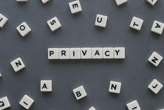 Privacy word made of square letter word on grey background. Privacy word made of square letter word on grey background royalty free stock image