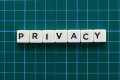 Privacy word made of square letter word on green background. Privacy word made of square letter word on green background royalty free stock images