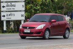 Privat-Eco-Stadt Auto Suzuki Swift Lizenzfreies Stockfoto
