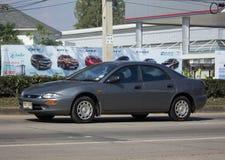 Privat gammal bil Mazda 323 Royaltyfri Bild