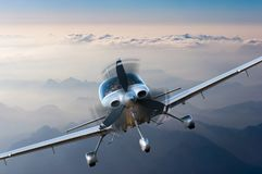 Privat light airplane or aircraft fly on mountain background. VIP travel concept. Privat light airplane or aircraft fly on mountain background. Travel concept stock photos