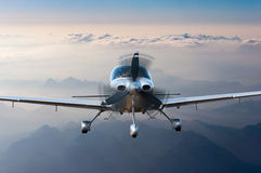 Privat light airplane or aircraft fly on mountain background. VIP travel concept Royalty Free Stock Photography