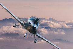 Privat light airplane or aircraft fly on mountain background. VIP travel concept Stock Photos