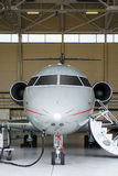 Privat stråle i hangar royaltyfria foton