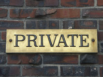Private. Brass private sign on brick wall Stock Image