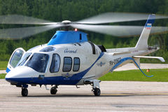 Private Agusta A109S Grand helicopter RA-01903 standing at Semyazino airfiled. VLADIMIR, RUSSIA - JUNE 2, 2015: Private Agusta A109S Grand helicopter RA-01903 Royalty Free Stock Photo