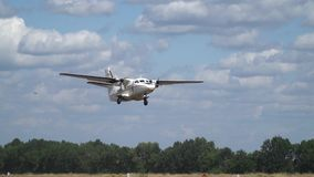 Private aircraft L-410 takes off over the field of it fly a bird, slow motion. Private aircraft L-410 slowly takes off in nature on a summer day against the stock footage