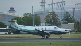 Private airplane accelerate before take-off. FRANKFURT AM MAIN, GERMANY - SEPTEMBER 5, 2015: Private airplane Pilatus PC-12/47 SP-NWM accelerate before take-off stock footage