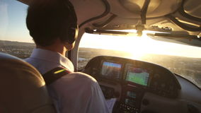 Private Airplane Pilot Flying at Sunset View Stock Images