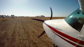 Private airplane on the runway. View from an aircraft wing. stock footage