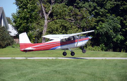 Private airplane taking off. Light private airplane taking off side view stock images