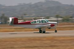 Private airplane taking off -. Private airplane taxiing on runway ready for takeoff. Panning shot Royalty Free Stock Image