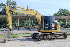 Private backhoe work for change railroad sleeper Stock Image
