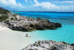 Private Beach. A girl enjoy the whole beach on her own on Half Moon Cay (The Bahamas Royalty Free Stock Images