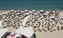 Private beach. View from above of a private beach in Mamaia, Constanta county, Romania, with beach umbrellas and chairs on the shore Stock Image