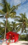 Private beach front bungalow in bright red color. Exclusive red hut in exotic Caribbean destination stock images