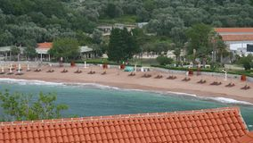 Private beach of the hotel Sveti Stefan, near the island. Monten stock video footage