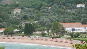Private beach of the hotel Sveti Stefan, near the island. Monten stock video