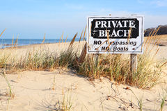 Private Beach in  Michigan. A Private Beach sign on the beach on Lake Michigan Royalty Free Stock Photo