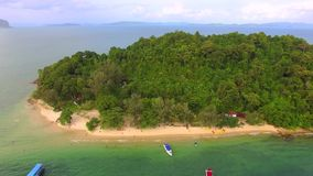 Private beach sea in Thailand, aerial shot. Island coast private beach boat sea in Thailand, aerial shot stock video footage
