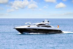 Private beautiful yacht sailing fast close to Alicante coast in Spain. Stock Photo