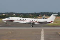 Private bizjet. Landing at the airport Stock Image