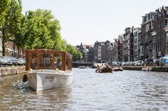 Private boat in canal in Amsterdam Royalty Free Stock Photography