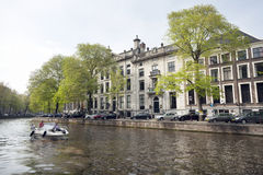 Private boat in Golden bend of herengracht on sunny day in amste Stock Images