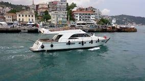 Private boat traveling along the Bosphorus, Istanbul, Turkey Stock Photo