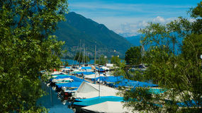 Private boats on Lake Langensee in Switzerland in the city of Ascona. Royalty Free Stock Photo