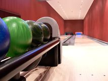 Private Bowling Alley. A private bowling alley with two lanes.  All the balls are lined up on the rack Stock Image