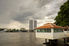 Private buildings along river in Bangkok Royalty Free Stock Photo