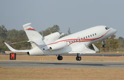Private business jet. Side view of private business jet taking off from runway royalty free stock photo