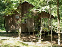 Private cabin in the woods. Small private cabin next to a fishing pond Stock Image