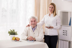 Private caregiver and old man Stock Images