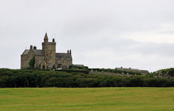 Private Castle in Sligo county, Ireland. Private Castle on the cape, coast in Sligo county during rainy weather, Ireland Stock Photos
