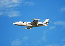 Private charter jet in flight