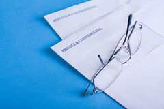 Private & Confidential envelopes, with glasses. Stock Images