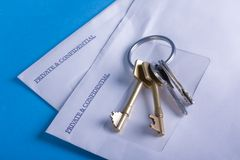 Private & Confidential envelopes, with keys. Royalty Free Stock Photos